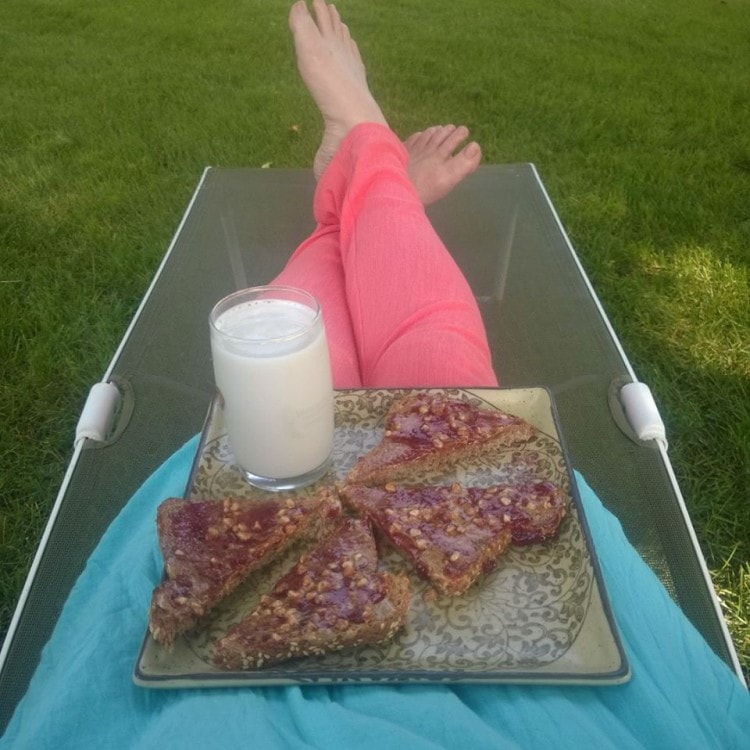 Almond butter and jelly sandwich with a side of almond milk - I use ezekiel toast - my favorite